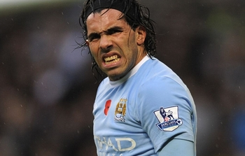 MANCHESTER, UNITED KINGDOM - NOVEMBER 7: Carlos Tevez of Manchester City grimaces during the Barclays Premier League match between Manchester City and Burnley at City of Manchester Stadium on November 7, 2009 in Manchester, England. (Photo by Michael Rega