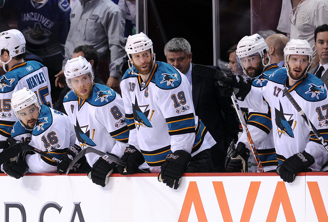VANCOUVER, CANADA - MAY 18:  (L-R) Devin Setoguchi #16, Joe Pavelski #8, Joe Thornton #19, Head Coach Todd McLellan, Patrick Marleau #12 and Torrey Mitchell #17 of the San Jose Sharks look on in the third period in Game Two of the Western Conference Final