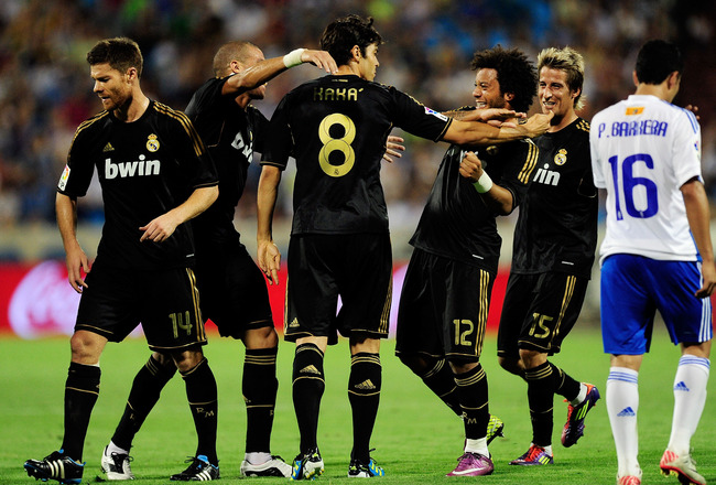 ZARAGOZA, SPAIN - AUGUST 28:  Kaka (8) of Real Madrid celebrates with teammates after scoring Real's 5th goal during the La Liga match between Real Zaragoza and Real Madrid at estadio La Romareda on August 28, 2011 in Zaragoza, Spain.  (Photo by Denis Doy