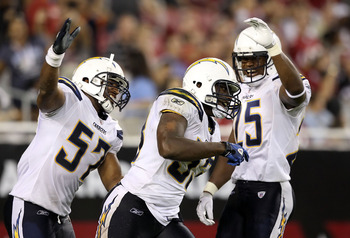 GLENDALE, AZ - AUGUST 27:  Linebacker Darryl Gamble #53 of the San Diego Chargers celebrates with Jonas Mouton #57 (L) and Darrell Stuckey #25 (R) after Gamble scored a 1 yard rushing touchdown after a fumble recovery against the Arizona Cardinals during