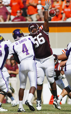 BLACKSBURG, VA - SEPTEMBER 18:  Defensive tackle Antoine Hopkins #56 of the Virginia Tech Hokies bats down a pass by quarterback Dominique Davis #4 of the East Carolina Pirates at Lane Stadium on September 18, 2010 in Blacksburg, Virginia.  (Photo by Geof