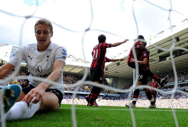 LONDON, ENGLAND - AUGUST 28:  Michael Dawson of Tottenham sits in the goal dejected as Edin Dzeko of Manchester City scores his third goal during the Barclays Premier League match between Tottenham Hotspur and Manchester City at White Hart Lane on August
