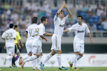 TIANJIN, CHINA - AUGUST 06:  Kaka of Real Madrid celebrates scoring a goal during the pre-season friendly match between Tianjin Teda and Real Madrid at Water Drop Stadium on August 6, 2011 in Tianjin, China.  (Photo by Feng Li/Getty Images)