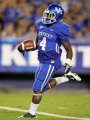 LEXINGTON, KY - SEPTEMBER 18: Raymond Sanders #14 of the Kentucky Wildcats scores a touchdown against the Akron Zips during the game  at Commonwealth Stadium on September 18, 2010 in Lexington, Kentucky.  (Photo by Andy Lyons/Getty Images)