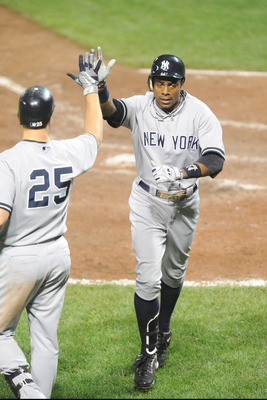 BALTIMORE, MD - AUGUST 28:  Curtis Granderson #14 of the New York Yankees celebrates a home run with Mark Teixeira #25 in the seventh inning during a baseball game against the Baltimore Orioles at Oriole Park at Camden Yards on August 28, 2011 in Baltimor