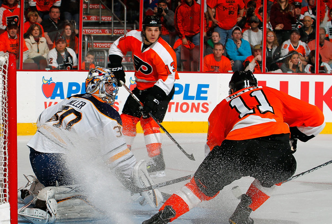 PHILADELPHIA, PA - APRIL 16:  Goalie Ryan Miller #30 of the Buffalo Sabres stops a shot by Blair Betts #11 of the Philadelphia Flyers as Daniel Carcillo #13 of the Flyers looks for a rebound in Game Two of the Eastern Conference Quarterfinals during the 2