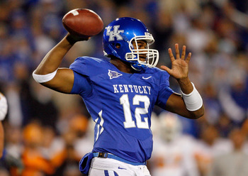 LEXINGTON, KY - NOVEMBER 28:  Morgan Newton #12 of the Kentucky Wildcats throws the ball against the Tennessee Volunteers during the SEC game at Commonwealth Stadium on November 28, 2009 in Lexington, Kentucky.  (Photo by Andy Lyons/Getty Images)
