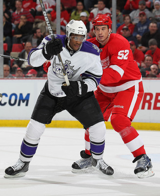 DETROIT, MI - MARCH 9:  Wayne Simmonds #17 of the Los Angeles Kings tries to break away from a check from Jonathan Ericsson #52 of the Detroit Red Wings in a game on March 9, 2011 at the Joe Louis Arena in Detroit, Michigan. (Photo by Claus Andersen/Getty