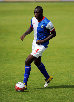 MORECAMBE, UNITED KINGDOM: - JULY 16: Chris Samba of Blackburn Rovers in action during the pre season friendly match between Morecambe and Blackburn Rovers at the Globe Arena on July 16, 2011 in Morecambe, England. (Photo by Clint Hughes/Getty Images)