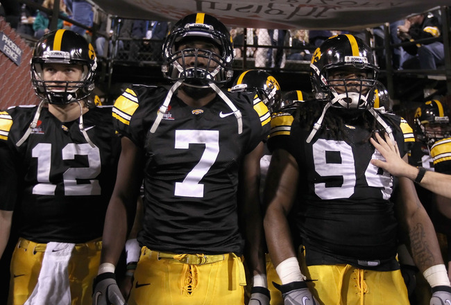 TEMPE, AZ - DECEMBER 28:  (L-R) Ricky Stanzi #12, Marvin McNutt #7 and Adrian Clayborn #94 of the Iowa Hawkeyes walk out onto the field for the Insight Bowl against the Missouri Tigers at Sun Devil Stadium on December 28, 2010 in Tempe, Arizona. The Hawke