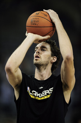 BARCELONA, SPAIN - OCTOBER 07: Pau Gasol #16 of the Los Angeles Lakers shoots a free throw during the warm up before the NBA Europe Live match between Los Angeles Lakers and Regal FC Barcelona at the at Palau Blaugrana on October 7, 2010 in Barcelona, Spa