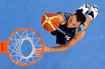 BEIJING - AUGUST 10:  Manu Ginobili of Argentina lays the ball up while taking on Lithuania during the day 2 preliminary game at the Beijing 2008 Olympic Games in the Beijing Olympic Basketball Gymnasium on August 10, 2008 in Beijing, China.  (Photo by Ph