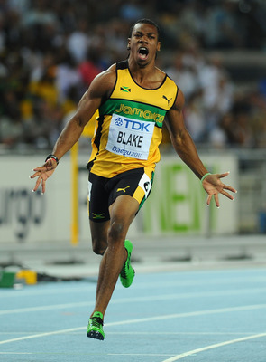 DAEGU, SOUTH KOREA - AUGUST 28:  Yohan Blake (L) of Jamaica celebrates winning the men's 100 metres final during day two of the 13th IAAF World Athletics Championships at the Daegu Stadium on August 28, 2011 in Daegu, South Korea.  (Photo by Stu Forster/G