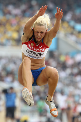 DAEGU, SOUTH KOREA - AUGUST 30:  Tatyana Chernova of Russia competes in the long jump in the women's heptathlon during day four of the 13th IAAF World Athletics Championships at the Daegu Stadium on August 30, 2011 in Daegu, South Korea.  (Photo by Andy L