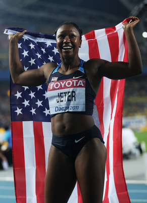 DAEGU, SOUTH KOREA - AUGUST 29:  Carmelita Jeter of United States celebrates after winning the women's 100 metres final during day three of the 13th IAAF World Athletics Championships at the Daegu Stadium on August 29, 2011 in Daegu, South Korea.  (Photo