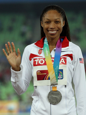 DAEGU, SOUTH KOREA - AUGUST 29:  Allyson Felix of the USA poses with her silver medal after the women's 400 metres final during day three of the 13th IAAF World Athletics Championships at the Daegu Stadium on August 29, 2011 in Daegu, South Korea.  (Photo