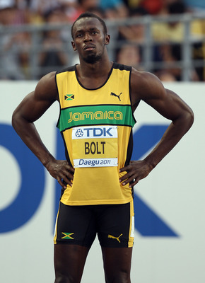 DAEGU, SOUTH KOREA - AUGUST 28:  Usain Bolt of Jamaica looks on before his men's 100 metres semi finals during day two of the 13th IAAF World Athletics Championships at the Daegu Stadium on August 28, 2011 in Daegu, South Korea.  (Photo by Michael Steele/