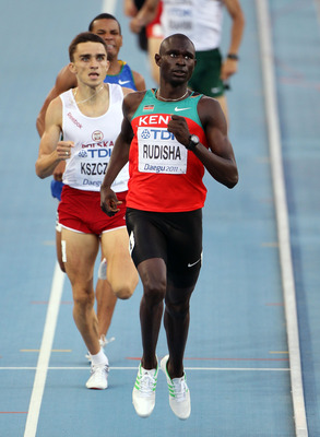 DAEGU, SOUTH KOREA - AUGUST 28:  David Lekuta Rudisha of Kenya leads the pack during the men's 800 metres semi finals during day two of the 13th IAAF World Athletics Championships at the Daegu Stadium on August 28, 2011 in Daegu, South Korea.  (Photo by A