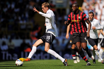 LONDON, ENGLAND - AUGUST 28:  Peter Crouch (R) of Tottenham controls the ball under pressure from Yaya Toure of Manchester City during the Barclays Premier League match between Tottenham Hotspur and Manchester City at White Hart Lane on August 28, 2011 in