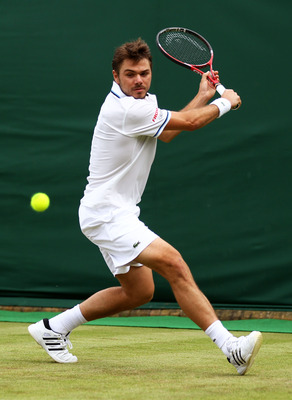 LONDON, ENGLAND - JUNE 22:  Stanislas Wawrinka of Switzerland returns a shot during the his second round match against  Simone Bolelli of Italy on Day Three of the Wimbledon Lawn Tennis Championships at the All England Lawn Tennis and Croquet Club on June