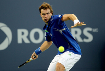 MONTREAL, QC - AUGUST 11:  Ernests Gulbis of Latvia returns a shot to Mardy Fish during the Rogers Cup at Uniprix Stadium on August 11, 2011 in Montreal, Canada.  (Photo by Matthew Stockman/Getty Images)