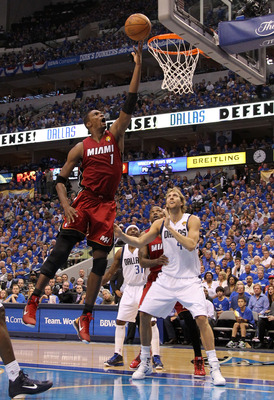 DALLAS, TX - JUNE 07:  Chris Bosh #1 of the Miami Heat attempts a shot against Dirk Nowitzki #41 of the Dallas Mavericks in the first half of Game Four of the 2011 NBA Finals at American Airlines Center on June 7, 2011 in Dallas, Texas. NOTE TO USER: User