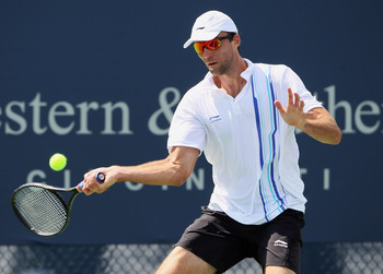 MASON, OH - AUGUST 16:  Ivo Karlovic of Croatia returns a shot to Florian Mayer of Germany during the Western & Southern Open at the Lindner Family Tennis Center on August 16, 2011 in Mason, Ohio.  (Photo by Elsa/Getty Images)