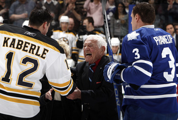 TORONTO, CANADA - MARCH 19: Howie Meeker shakes Tomas Kaberle #12 of the Boston Bruins' hand  with Dion Phaneuf #3 of the Toronto Maple Leafs before game action at the Air Canada Centre March 19, 2011 in Toronto, Ontario, Canada. (Photo by Abelimages/Gett