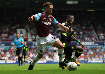 LONDON, ENGLAND - AUGUST 21:  Scott Parker of West Ham and Max-Alain Gradel of Leeds battle for the ball during the npower Championship match between West Ham United and Leeds United at Boleyn Ground on August 21, 2011 in London, England.  (Photo by Dean