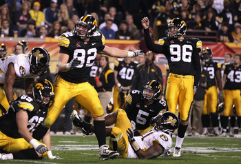 TEMPE, AZ - DECEMBER 28:  Kicker Michael Meyer #96 of the Iowa Hawkeyes kicks a 34 yard field goal against the Missouri Tigers during the Insight Bowl at Sun Devil Stadium on December 28, 2010 in Tempe, Arizona.  (Photo by Christian Petersen/Getty Images)