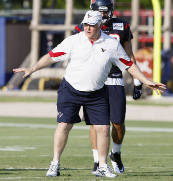 HOUSTON, TX - AUGUST 01:  Defensive Coordinator Wade Phillips of the Houston Texans goes over plays with the defense during practice on the first day of training camp at Reliant Park on August 1, 2011 in Houston, Texas.  (Photo by Bob Levey/Getty Images)