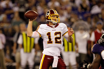 BALTIMORE, MD - AUGUST 25:  Quarterback John Beck #12 of the Washington Redskins looks to pass against the Baltimore Ravens during the second half of a preseason game at M&T Bank Stadium on August 25, 2011 in Baltimore, Maryland. The Ravens defeated the R
