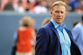 DENVER, CO - AUGUST 27: Executive Vice President of Football Operations John Elway for the Denver Broncos watches the preseason game at Sports Authority Field at Mile High on August 27, 2011 in Denver, Colorado.  (Photo by Garrett W. Ellwood/Getty Images)