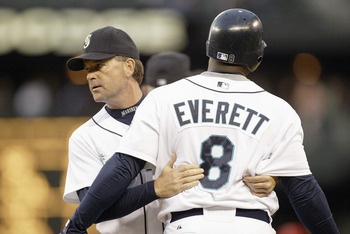 SEATTLE - JULY 5: First base coach Mike Goff #47  holds back Carl Everett #8 of the Seattle Mariners as he argues with second base umpire Chuck Meriwether #14 during the game against the Los Angeles Angels of Anaheim on July 5, 2006 at Safeco Field in Sea