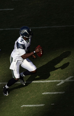 SAN DIEGO, CA- AUGUST 11:  Quarterback Tarvaris Jackson #7 of  the Seattle Seahawks rolls back in the pocket against  the San Diego Chargers during their  NFL preseason game at Qualcomm Stadium in San Diego, California on August 11, 2011. (Photo by Donald