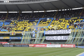 VERONA, ITALY - MAY 15: Fans of Chievo cheer during the Serie A match between AC Chievo Verona and Udinese Calcio at Stadio Marc'Antonio Bentegodi on May 15, 2011 in Verona, Italy. (Photo by Dino Panato/Getty Images)