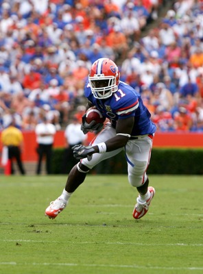 GAINESVILLE, FL - SEPTEMBER 01:   Jarrod Fayson #11 of the Florida Gators picks up yardage agianst the Western Kentucky Hilltoppers on September 1, 2007 at Ben Hill Griffin Stadium in Gainesville, Florida.  The Gators won the game 49-3.  (Photo by Sam Gre