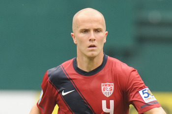 WASHINGTON, DC - JUNE 19:  Michael Bradley #4 of the United States dribbles the ball against Jamaica during the 2011 Gold Cup Quarterfinals on June 19, 2011 at RFK Stadium in Washington, D.C.  The United States won 2-0.  (Photo by Mitchell Layton/Getty Im