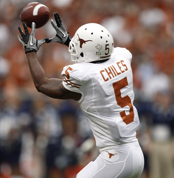HOUSTON - SEPTEMBER 04:  Wide receiver John Chiles #5 of the Texas Longhorns completes a reception against the Rice Owls at Reliant Stadium on September 4, 2010 in Houston, Texas.  (Photo by Bob Levey/Getty Images)