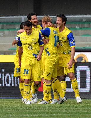 VERONA, ITALY - MAY 01:  Luca Rigoni of Chievo #16 celebrates with his team-mates after scoring his opening goal during the Serie A match between AC Chievo Verona and Lecce at Stadio Marc'Antonio Bentegodi on May 1, 2011 in Verona, Italy.  (Photo by Dino
