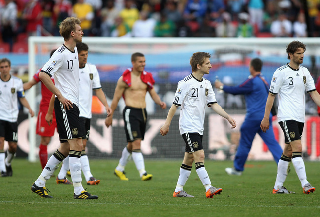 PORT ELIZABETH, SOUTH AFRICA - JUNE 18: Per Mertesacker, Marko Marin and Arne Friedrich of Germany leave the field dejected after the 2010 FIFA World Cup South Africa Group D match between Germany and Serbia at Nelson Mandela Bay Stadium on June 18, 2010