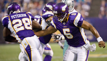 MINNEAPOLIS, MN - AUGUST 27: Donovan McNabb #5 of the Minnesota Vikings hands the ball to Adrian Peterson #28 in the first half on August 27, 2011 at Hubert H. Humphrey Metrodome in Minneapolis, Minnesota. (Photo by Hannah Foslien/Getty Images)