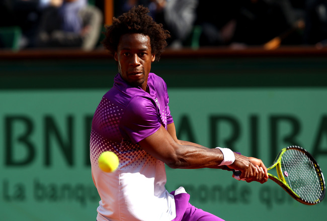PARIS, FRANCE - MAY 31:  Gael Monfils of France hits a backhand during the men's singles quarterfinal match between Gael Monfils of France and Roger Federer of Switzerland on day ten of the French Open at Roland Garros on May 31, 2011 in Paris, France.  (