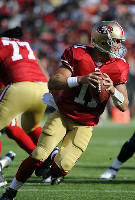 SAN FRANCISCO - AUGUST 27: Alex Smith #11 of the San Francisco 49ers roles out to pass against the Houston Texans during an NFL pre-season football game at Candlestick Park August 27, 2011 in San Francisco, California. (Photo by Thearon W. Henderson/Getty