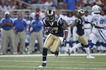 ST. LOUIS, MO - AUGUST 13: Quintin Mikell #27 of the St. Louis Rams returns an interception during the first half of the NFL preseason game against the Indianapolis Colts at Edward Jones Dome on August 13, 2011 in St. Louis, Missouri. (Photo by Joe Robbin