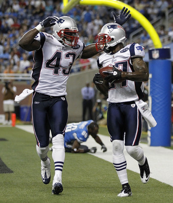 DETROIT - AUGUST 27:  Kyle Arrington #27 of the New England Patriots celebrates with teammate James Ihedigbo #43 after intercepting a pass intended for Nate Hughes #86 of the Detroit Lions in the third quarter of the game at Ford Field on August 27, 2011