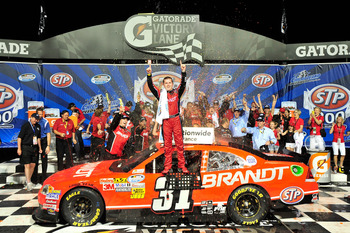 JOLIET, IL - JUNE 04:  Justin Allgaier, driver of the #31 Brandt Chevrolet, celebrates in victory lane after winning the NASCAR Nationwide Series STP 300 at Chicagoland Speedway on June 4, 2011 in Joliet, Illinois.  (Photo by Jason Smith/Getty Images for