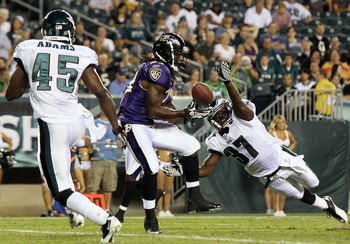 PHILADELPHIA, PA - AUGUST 11:  Damien Berry #23 of the Baltimore Ravens can't hold onto the ball in the endzone as Jamar Wall #37 and Jamar Adams #45 of the Philadelphia Eagles defend during a preseason game on August 11, 2011 at Lincoln Financial Field i