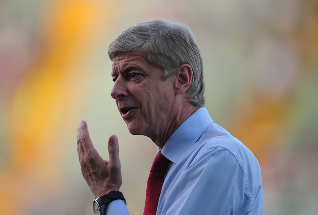 UDINE, ITALY - AUGUST 24:  Arsenal manager Arsene Wenger looks on during the UEFA Champions League play-off second leg match between Udinese Calcio and Arsenal FC at the Stadio Friuli on August 24, 2011 in Udine, Italy.  (Photo by Jamie McDonald/Getty Ima
