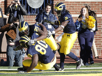 ANN ARBOR, MI - NOVEMBER 06:  Junior Hemingway #21 of the Michigan Wolverines celebrates a two point conversion in triple overtime while playing the Illinios Fighting Illini with Vincent Smith #2 and Martell Webb #80 at Michigan Stadium on November 6, 201